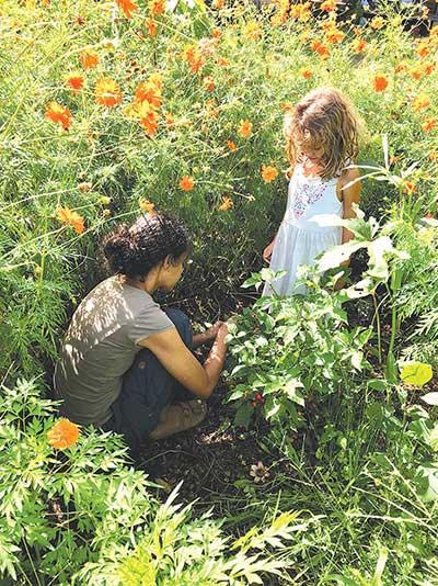 Yanna Mohan Muriel at Finca Marisol while observing soil health