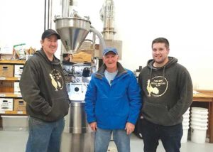 Andrew Newell, owner of Farmhouse Coffee Roasters, with his father Michael Newell and employee Garrett Greystone. Photo courtesy of Andrew Newell