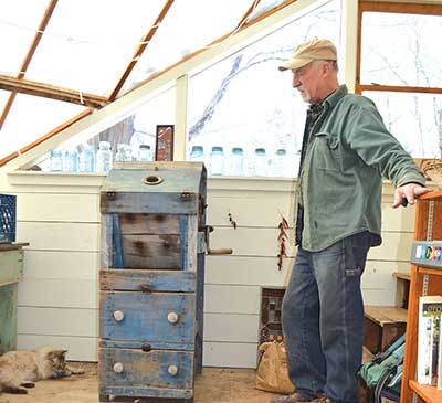 Albie Barden admiring a Benjamin & Co. corn sheller made in Winthrop, Maine, in the 1800s