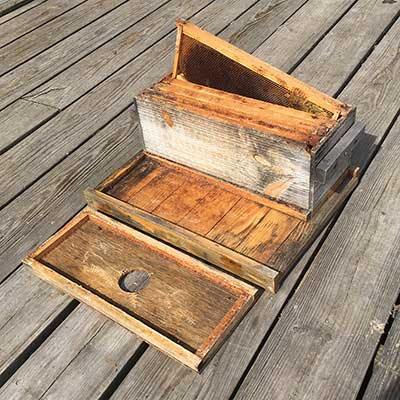 Hive components for a two-queen, side-by-side, four-frame beehive