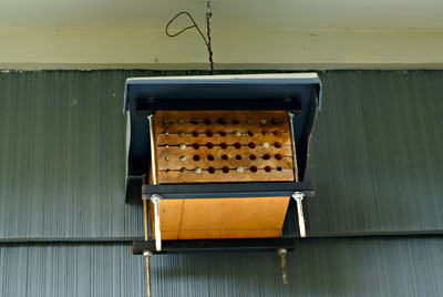 Fig. 8. A bee condo hanging under an eave.