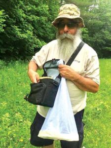 Eric Frohmberg with his bee collecting kit. Photo courtesy of the Frohmbergs