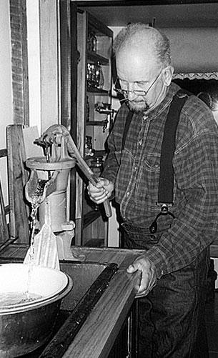 Larry Perron pumping water