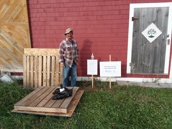 Don Pendleton, MOFGA building and grounds assistant, at MOFGA's greenhouse plastic drop-off site in Unity.